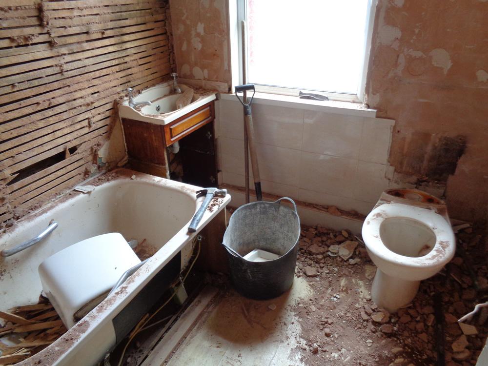 Bathroom lath, plaster and bricks exposed during bathroom renovation