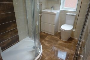Shower Room with Modern Storage Basin sink and Toilet