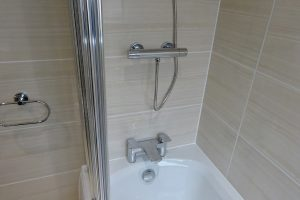 Bathroom fitted with Tavistock Strike with bath mixer taps