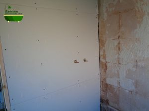 Hot and cold water shower feeds buried and hidden in bathroom wall behind the plaster board