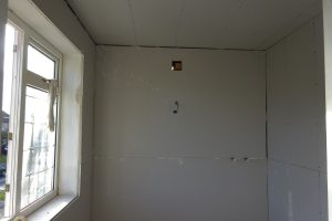 Build studded wall in ensuite bathroom and plaster board