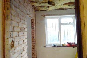 Doorway cut from ensuite bathroom wall into master bedroom