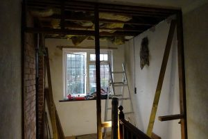 Wall between hallway and ensuite bathroom removed