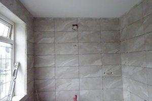 Fully tiled ensuite bathroom walls