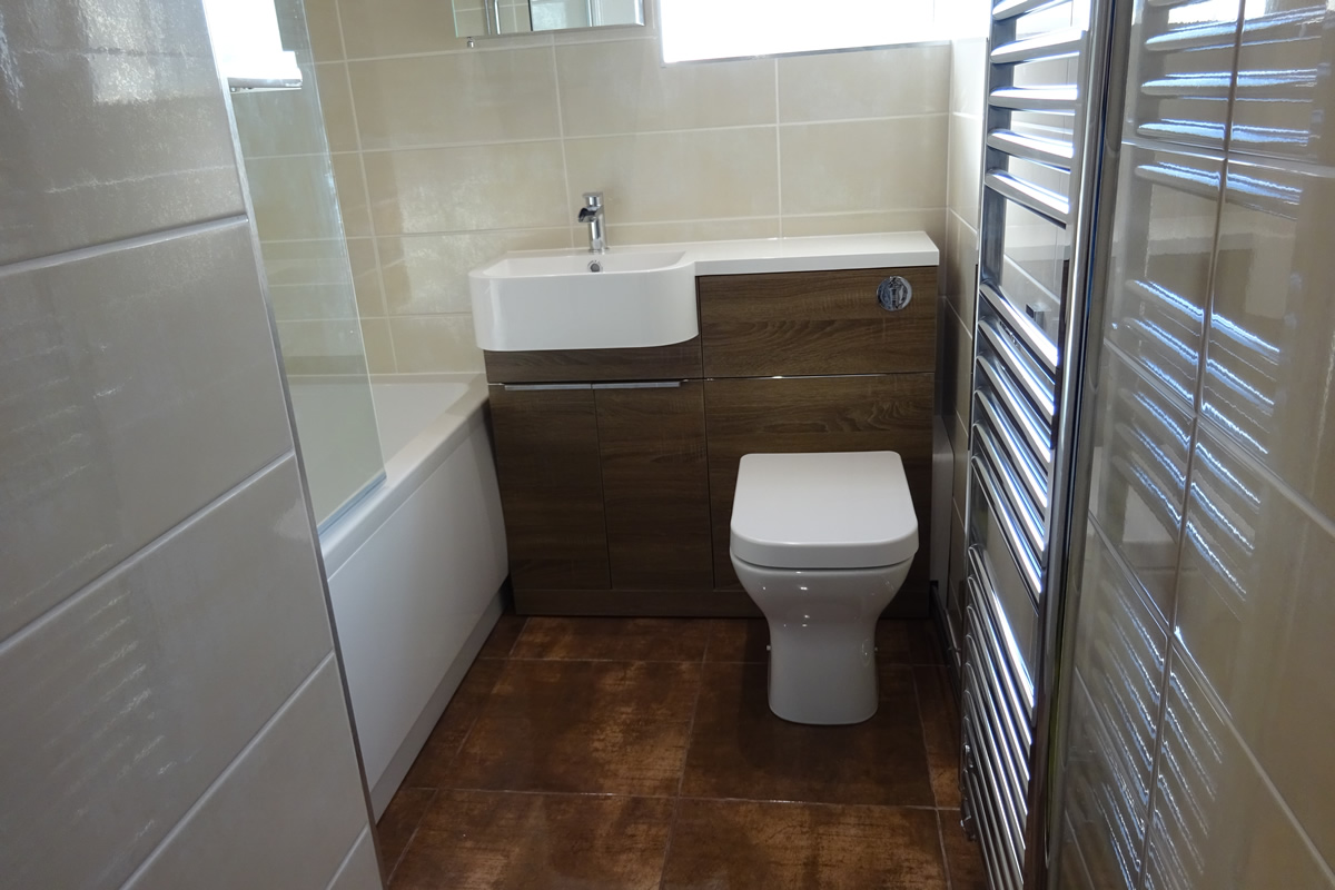 Bathroom fitted with tavistock match vanity in havana oak johnson zeppelin bronze floor tile dailygadgetfo Choice Image