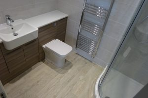 Ensuite with fitted furniture and quadrant shower