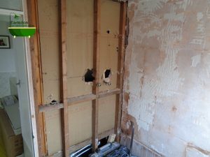 Bathroom tiles removed exposing timber wall frame