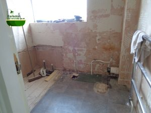Bathroom tiles removed from bathroom walls and floor