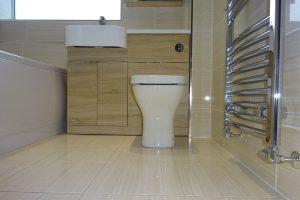 British ceramic tile Serpentine beige floor tile and chrome towel warmer
