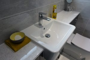 Fitted bathroom storage with white work top