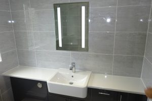 Bathroom fitted with LED mirror wall cabinet