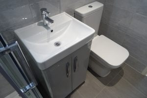 Ensuite with tavistock compass vanity basin and toilet
