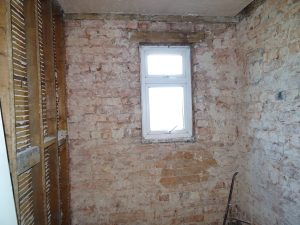 Bathroom stripped down to brick in Coventry