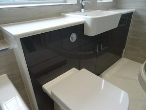 Bathroom fitted with grey bathroom fitted furniture