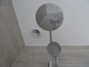 Bathroom with ceiling extractor fitted over the shower area of the bathroom