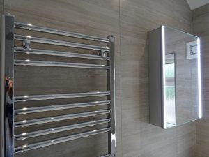 Tavistock LED sleek mirror fitted on bathroom wall