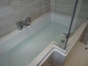 Trojancast reinforced L shaped shower bath