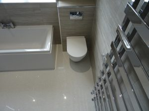 Bathroom with wall hung toilet pan