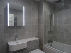 Fitted bathroom with Tavistock Sleek Mirror Cabinet