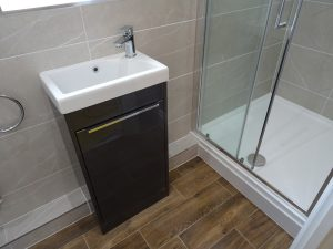 Ensuite Shower room with gloss gray Tvistock Sequence vanity unit