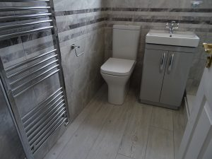 Shower room Coventry with grey wood effect floor tiles and grey wall tiles