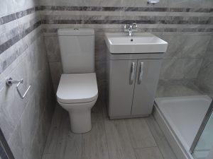 Shower room with Tavistock compass light grey vanity basin unit
